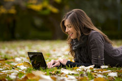 Woman working with a laptop. Beautiful woman working with a laptop in outdoor Royalty Free Stock Images