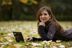 Woman working with a laptop. Beautiful woman working with a laptop in outdoor Stock Image