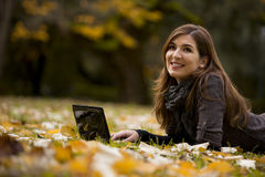 Woman working with a laptop. Beautiful woman working with a laptop in outdoor Stock Photography