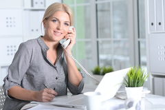 Woman working with laptop Royalty Free Stock Photos