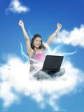 Woman working on laptop in Cloud Royalty Free Stock Image