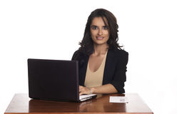Woman working on laptop computer Stock Images