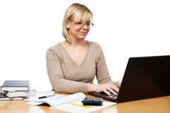 Woman working with laptop computer in office Stock Images