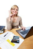 Woman working with laptop computer in office Royalty Free Stock Photography