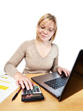 Woman working with laptop computer in office Royalty Free Stock Images