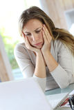 Woman working on laptop getting tired Stock Photo
