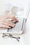 Woman working on laptop Royalty Free Stock Photos