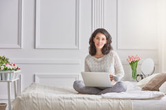 Woman working on a laptop Stock Photos