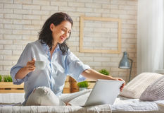 Woman working on a laptop Royalty Free Stock Photo