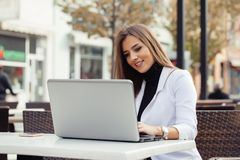 Woman working with a laptop Stock Images