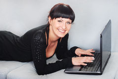 Woman working with laptop in home Stock Photo