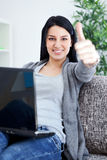 Woman working on laptop at home Stock Photography