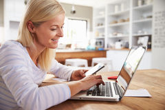 Woman working on laptop at home Royalty Free Stock Image