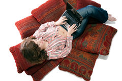 Woman working on laptop at home Stock Image
