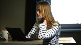 Woman working with laptop at home stock footage