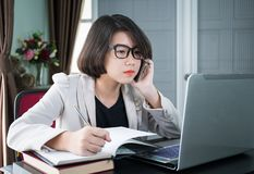 Woman working on laptop in home office Royalty Free Stock Photography