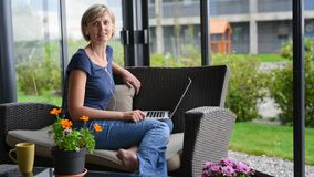 Woman working with laptop at home stock video footage
