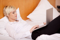 Woman Working On Laptop Stock Images