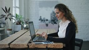 The woman working  by laptop stock footage