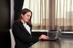 Woman working on laptop in the office Stock Photography