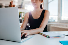 Woman working on laptop at office Royalty Free Stock Photo