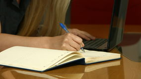 Woman Working on laptop at office stock video footage
