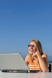 Woman working with laptop outdoor Royalty Free Stock Photos