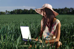 Woman working with a laptop outdoor. Young woman working with a laptop outdoor stock image