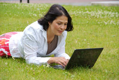 Woman working on laptop outside Royalty Free Stock Photography