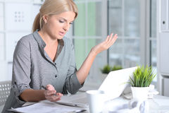 Woman working with laptop Stock Images