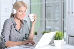 Woman working with laptop Royalty Free Stock Image