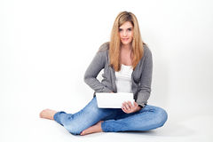 Woman working on laptop while sitting on the floor Stock Photography