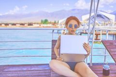 A woman is working on vacation. stock photography