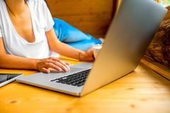 Woman working with laptop on the wooden floor Royalty Free Stock Photography