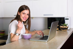 Woman working at the laptop. Young pretty woman working at the laptop Royalty Free Stock Image