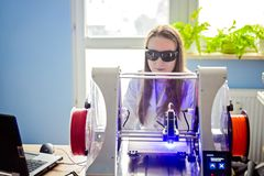 Woman working with laser engraver Royalty Free Stock Photo
