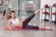 Woman working lateral abs Stock Photo