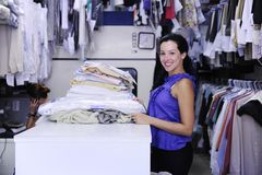 Woman working at a laundry Royalty Free Stock Photography