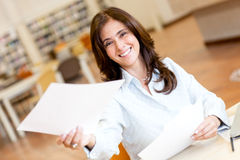 Woman working at the library Stock Images