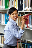 Woman working in library Royalty Free Stock Images