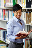 Woman working in library Stock Photos