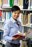 Woman working in library Stock Image