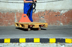Woman working at loading trolley Stock Images