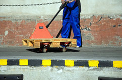 Woman working at loading trolley Stock Photos