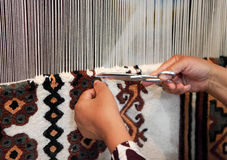 Woman working at the loom. Close up Royalty Free Stock Photos