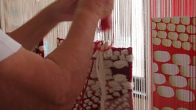 Woman working at the loom stock video footage