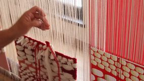Woman working at the loom stock footage