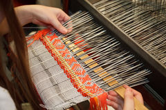 Woman working at the loom. Russian national crafts Stock Image