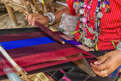 Woman working at the loom. thai national crafts. Royalty Free Stock Images