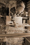 Woman working at the loom Stock Images